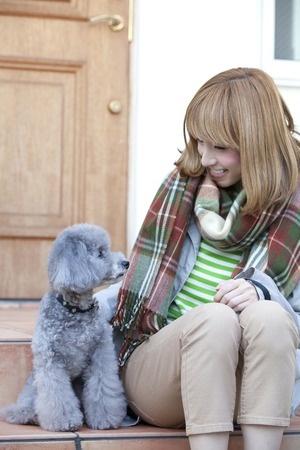 Woman saying goodbye to her poodle